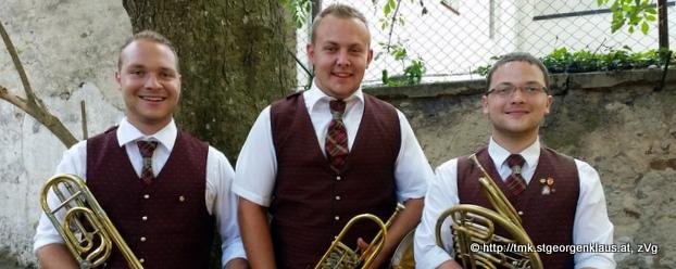 Drei Musiker mit Gold JMLA